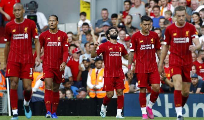 Jugadores del Liverpool luego de su victoria ante el Arsenal / Foto: AP